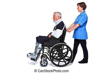 Enfermera, herido, hombre, sílla de ruedas, aislado