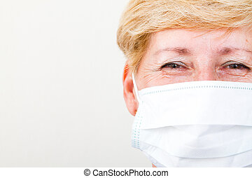 senior female doctor with mask