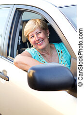 senior woman driver - happy senior woman driver inside a car