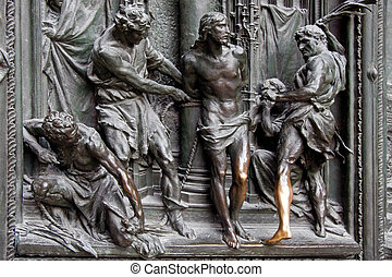 Detail of the main door at the Duomo Cathedral Milan Italy
