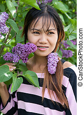 Beautiful Thai woman with braces in the park