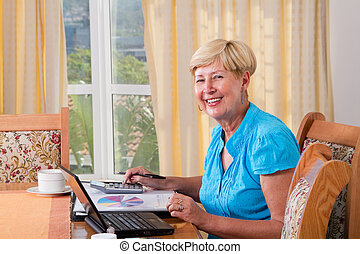 senior woman calculating finance