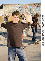 teen boys with skateboard - group of young teen boys...