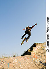 teen boy skateboarding - teen boy skateboarder playing on...