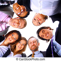 Group of business people standing in huddle, smiling, low...