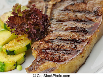 barbecue T Bone steak close up - fresh and juicy t-bone...
