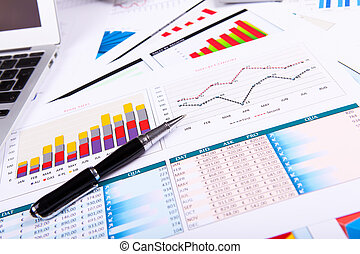 Graphs, charts, business table The workplace of business...