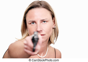 Tough woman raises gun - Tough blonde woman raises a gun,...