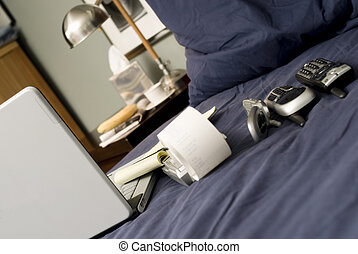 Telecommuter's Morning - Bed with a laptop, three phones and...