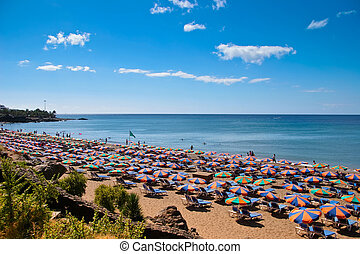 People relaxing on a beach in Lanzarote Spain