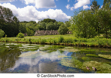 Arlington Row in Bibury with River Coln, Cotswolds,...
