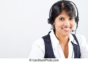 young indian business woman or telephone operator with...