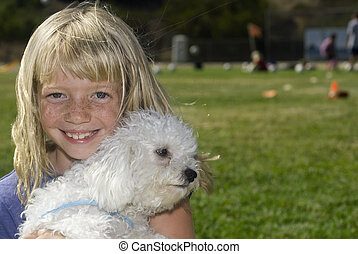 Cute Girl with Best friend - Young girl holding her dog.