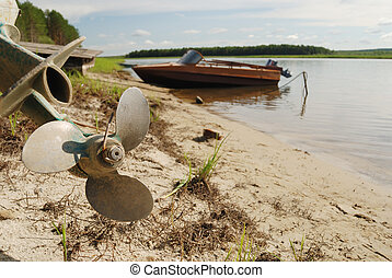 screw propeller, motor boats on the shore of the river