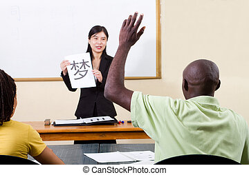 raising hand in chinese classroom - male african american...