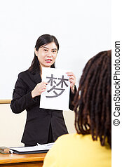 teacher teaching chinese language - female teacher teaching...