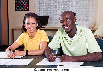 african students in classroom - two african students in...