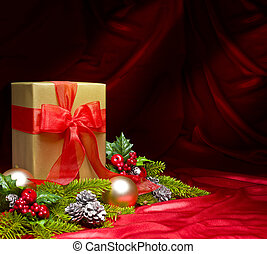 Present decorated with red satin and Christmas decoration,...