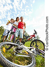 Family with bikes  - Portrait of a family standing by bike