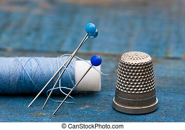 thread, needles and thimble