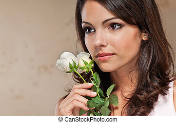 Young woman holding roses