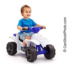 Little boy on toy car - Little boy sitting on plastic toy...