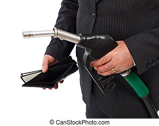 Gas nozzle and empty wallet - Man's hand holding gas nozzle...