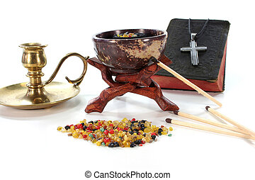 colorful frankincense with incense censer on a white...