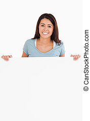 Attractive woman holding a  board