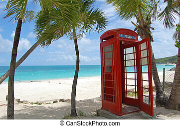 Antigua phone box - red telephone box on beach in Antigua
