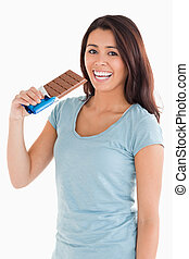 Lovely woman eating a chocolate bar