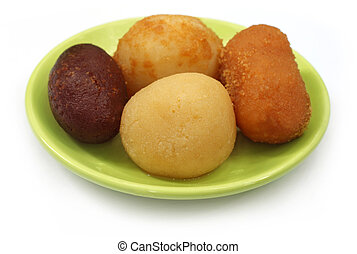 Sweetmeats on a plate over white background