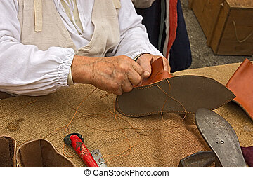 shoemaker - elderly shoemaker make antique model of shoes