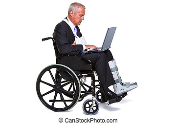 Injured businessman on laptop in a wheelchair isolated -...