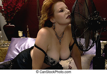 Hot Summer Nights - Sultry redhead cooling off in bed with...