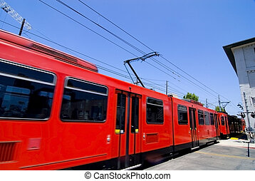 Red Trolley - Speeding red trolley with motion blur. San...