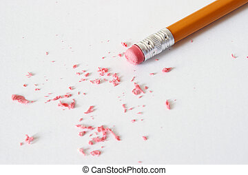 Erasing - A pencil is making corrections by erasing the...