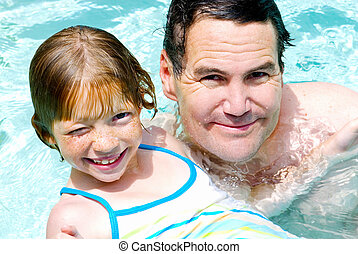 Daddy and Daughter Swim Lesson - Father and Daughter in the...