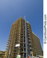 High Rise Under Construction - High rise with scaffolding...