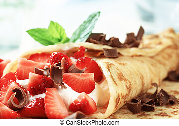 Crepes with cheese and strawberries sprinkled with chocolate...
