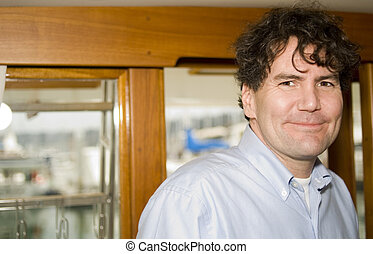 Man on a Yacht - Portrait of an affluent man in the cabin of...