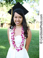 Pretty Asian Woman Graduation - A pretty young asian woman...
