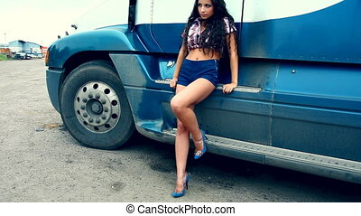 Young girl relax near lorry truck at summer sunset