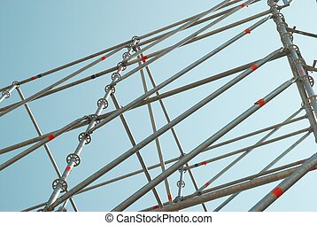 Part of the construction scaffold with blue background