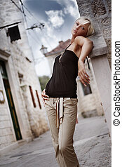 Amaizing blonde woman on the street in vacation day