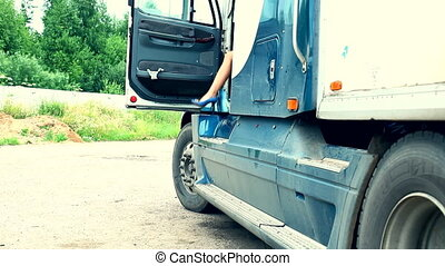 Young girl exit from truck and repair