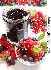 Berry jam - A glass of mixed berry jam with strawberries,...