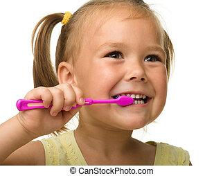 pequeno, menina, Limpeza, dentes, usando, escova de dentes