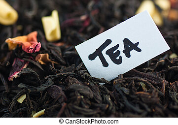 Tea - Close-up of tea blend with the words tea in a note