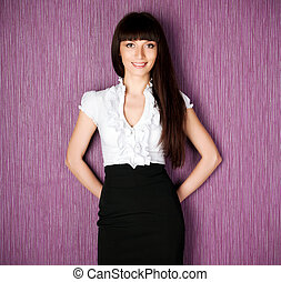 Confident woman smiling against a purple background